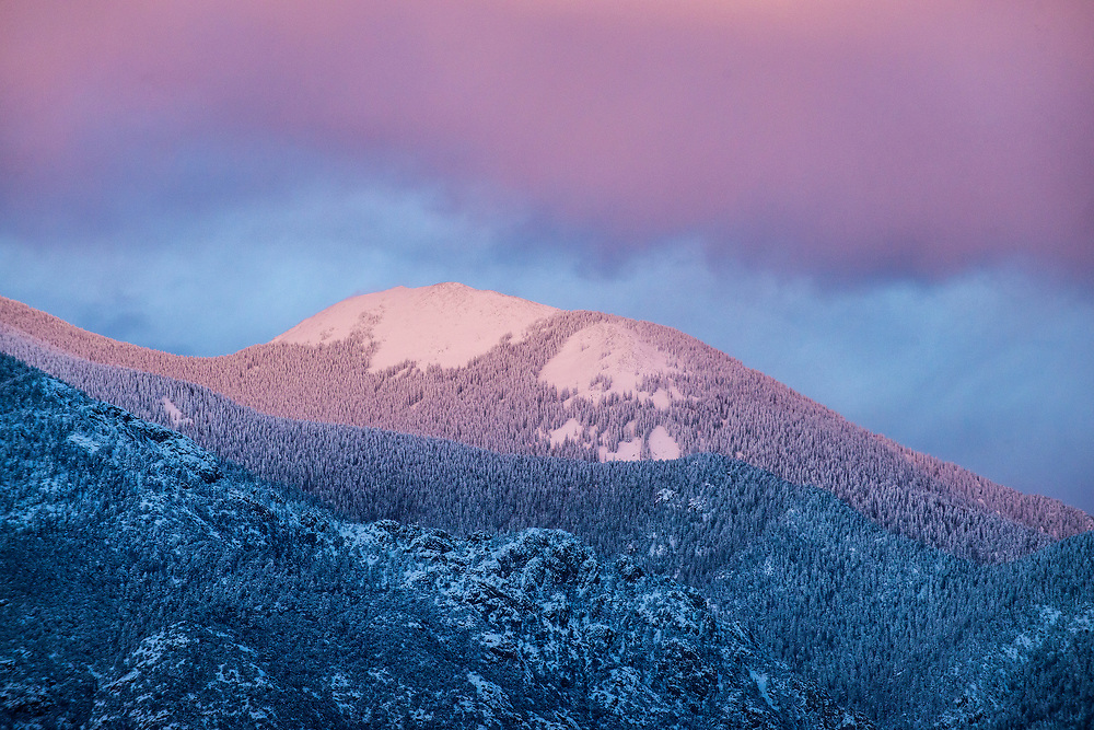After a three day snowfall, the Taos Mountains were enveloped in a cotton candy colored, magenta sky. Taos, New Mexico