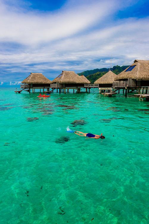 Lagoon view and overwater bungalows, Hilton Moorea Lagoon Resort, island of Moorea, French Polynesia.