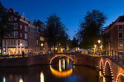 Canal and bridges corner Kaisersgracht and Leidsegracht in canal ring area, Jordaan district, Amsterdam