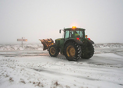 © Licensed to London News Pictures. 27/01/2014 North York Moors, England. A tractor snow plough continues to keep the main road across the North York Moors clear following another night of snow. Photo credit : Ian Forsyth/LNP