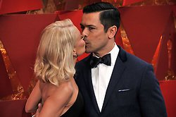 Kelly Rip and Mark Consuelos walking on the red carpet during the 90th Academy Awards ceremony, presented by the Academy of Motion Picture Arts and Sciences, held at the Dolby Theatre in Hollywood, California on March 4, 2018. (Photo by Sthanlee Mirador/Sipa USA)