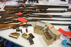 © Licensed to London News Pictures . 07/08/2014 . Manchester , UK . Greater Manchester Police displays some of the cache of firearms and ammunition they collected during a two week firearms amnesty in July , at the force's North Manchester headquarters , this morning (7th August 2014) . GMP reports collecting 225 firearms and over 3000 rounds of ammunition during the fortnight amnesty of which , they say, over 80 of the weapons were illegally owned . Amongst the haul were rifles, shotguns , handguns and air weapons as well as imitation and antique firearms . Photo credit : Joel Goodman/LNP