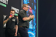 James Wade celebrates after drawing his match with Jose de Sousa during the PDC Premier League Darts Night 11 at Marshall Arena, Milton Keynes, United Kingdom on 6 May 2021.