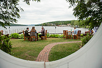 Diners sit lakeside at Lago in Meredith on Wednesday evening.  (Karen Bobotas/for the Laconia Daily Sun)