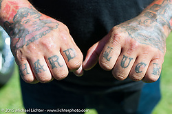 """Invited builder Bobby Middleton (King Kustoms, Lombard, IL) with his """"Hard Luck"""" knuckle tattoos on Friday - for the builder-invite bike check-in for the Born-Free 6 Vintage Chopper and Classic Motorcycle Show. Silverado, CA. USA. June 27, 2014.  Photography ©2014 Michael Lichter."""