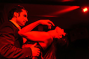 Juan and Agatha of Les Oiseaux Noirs Caberet perform in Roppongi, Zero Hour club, Tokyo, Japan, June 27, 2012. The group formed for just four performances in 2012 and mixed song, instrumental performance, pole dancing, tango and yoyo.
