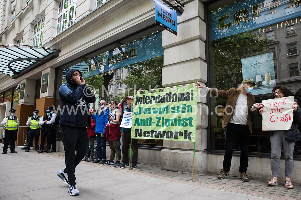 London, UK. 28th May, 2021. Activists from Palestine Action protest outside the UK headquarters of Elbit Systems, an Israel-based company developing technologies used for military applications including drones, precision guidance, surveillance and intruder-detection systems. The activists were protesting against Elbit's presence in the UK and against British arms sales to and support for Israel.