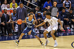 Dec 1, 2019; Morgantown, WV, USA; Rhode Island Rams guard Fatts Russell (1) dribbles while defended by West Virginia Mountaineers guard Miles McBride (4) during the second half at WVU Coliseum. Mandatory Credit: Ben Queen-USA TODAY Sports