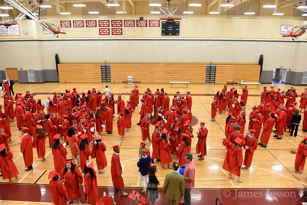 Students from the Class of 2017 convene in the gym before the 148th Graduation exercises at Wellesley High School on June, 2, 2017.   [Wicked Local Photo/James Jesson]
