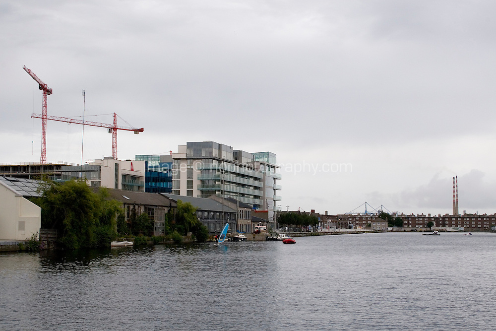 Grand Canal docks, Hanover Quay in Dublin, Ireland, view of the Ringsend power station chimneys in background