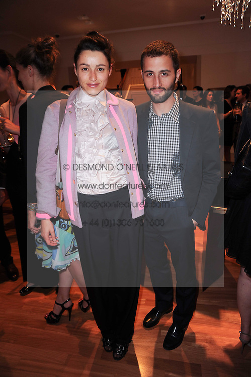 SEBASTIEN CLIVAZ and URSULA GEISSELMANN at a party to celebrate the B.zero 1 design by Anish Kapoor held at Bulgari, 168 New Bond Street, London n 2nd June 2010.