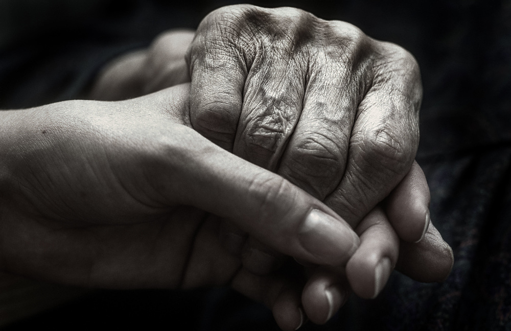 Holding hands, care home, UK