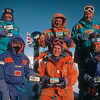 Members of the 1989-1990 Trans-Antarctica Expedition pose for sponsor pictures at the ceremonial South Pole, about halfway through their journey.