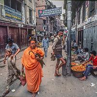People walk a back street in Kathmandu, Nepal.