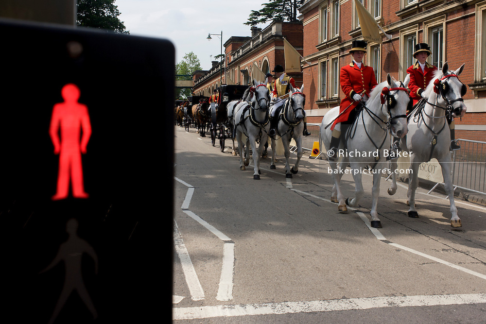 Members of the royal household's carriage troop process through Ascot during the annual Royal Ascot horseracing festival in Berkshire, England. Royal Ascot is one of Europe's most famous race meetings, and dates back to 1711. Queen Elizabeth and various members of the British Royal Family attend. Held every June, it's one of the main dates on the English sporting calendar and summer social season. Over 300,000 people make the annual visit to Berkshire during Royal Ascot week, making this Europe's best-attended race meeting with over £3m prize money to be won.