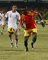 Photo: Steve Bond/Richard Lane Photography.<br />Guinea v Morocco. Africa Cup of Nations. 24/01/2008. Souleymane Youla (R) is pursued by Michael Basser (L)