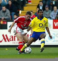 Photo. Chris Ratcliffe<br />Charlton v Arsenal. FA Premiership. 26/10/2003<br />Matt Holland fools Ashley Cole the wrong way at the Valley