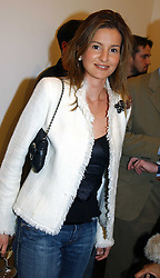 LAURA PIGORINI at an exhibition of photographs by Matthew Mellon entitled Famous Feet - featuring well known people wearing shoes from Harrys of London, held at Hamiltons Gallery, Carlos Place, London on 22nd November 2004.<br /><br />NON EXCLUSIVE - WORLD RIGHTS