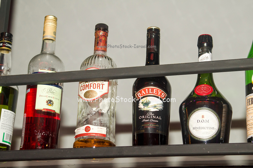 various bottles of alcohol on display in a bar