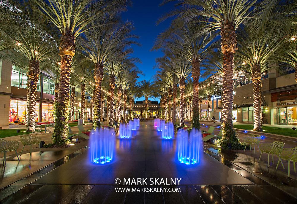 SCOTTSDALE, ARIZONA - MARCH 12: Splash pad lit up at night at the Scottsdale Quarter shopping center in Scottsdale, Arizona on March 12, 2013.  North Scottsdale is a desirable tourist destination.