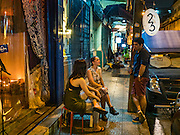 28 JANUARY 2016 - BANGKOK, THAILAND: People sit at a table in front of 23 Bar and Gallery in Bangkok.        PHOTO BY JACK KURTZ