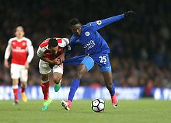 26 April 2016 London : Premier League Football : Arsenal v Leicester City :<br /> Theo Walcott of Arsenal pulls the shorts of Wilfred Ndidi.<br /> Photo: Mark Leech