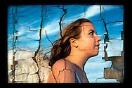 Closeup of teenage girl angel looking up to sky - peeling paint effect