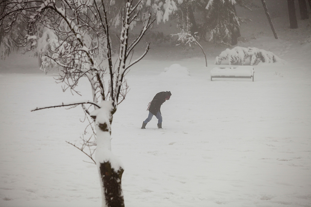 A man is seen during a snow storm in Sacher Park in Jerusalem, Israel, on February 20, 2015. Over 20 centimeters of snow covered Jerusalem overnight, causing school and road closures, as a powerful winter storm descended on parts of the Middle East on Friday.