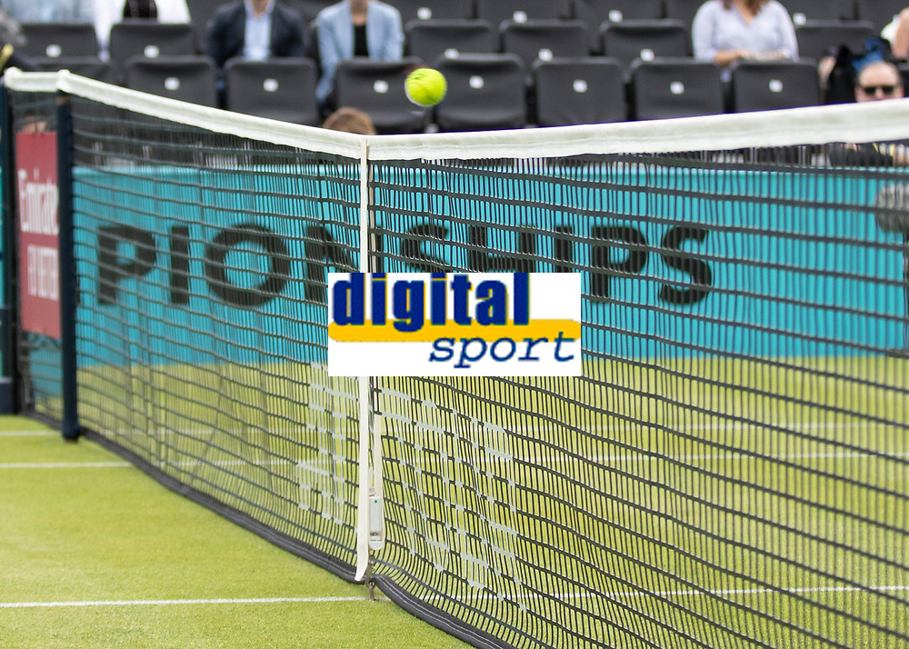 Tennis - 2019 Queen's Club Fever-Tree Championships - Day Three, Wednesday<br /> <br /> The tennis ball flies across the centre of the net as the players hit back and forth on Centre Court.<br />  <br /> COLORSPORT/DANIEL BEARHAM