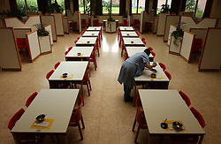 GHENT, BELGIM - OCT-22-2003 - A female prisoner cleans the visiting room at the Ghent prison.  (PHOTO © JOCK FISTICK)