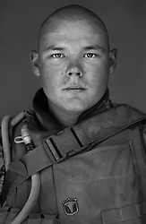 Navy Corpsman Kyle Hatch, 21, Myrtle Point, Oregon, 3rd Platoon, Kilo Co., Third Battalion First Marines, First Marine Division, United States Navy at the company's firm base in Hit, Iraq on Sept. 20, 2005.