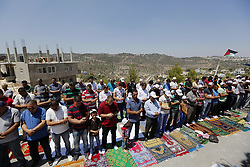 August 18, 2017 - Bethlehem, West Bank, Palestinian Territory - Palestinians take part in Friday prayer before a protest against alerts of the Israeli army to demolish houses, in the West Bank village of Walajeh, near Bethlehem, August 18, 2017  (Credit Image: © Wisam Hashlamoun/APA Images via ZUMA Wire)