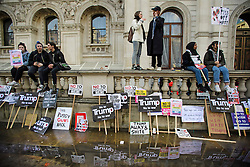 © Licensed to London News Pictures. 04/02/2017. London, UK. Banners left lying against a wall as thousand of protestors take part in a demonstration against U.S President Donald Trump's Executive Order banning refugees and immigrants from a number of Muslim-majority countries. Protestors join campaign groups including Stop the War, Stand up to Racism, Muslim Association of Britain, in a march from the U.S Embassy in London to Downing Street. Photo credit: Ben Cawthra/LNP