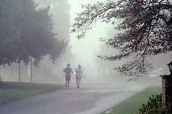 Heavy fog obscures joggers on Surf Avenue in Rehoboth Beach, Del., Saturday, Aug. 17, 2019. (Photo by D. Ross Cameron)