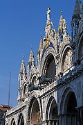 Front lit, diagonal shot of St. Mark's Basilica (Basilica di San Marco in Venezia),the most famous of the churches of Venice, Italy. The structure is one of the best examples of Byzantine architecture in the world. The building was also nicknamed Chiesa d'Oro ( church of gold ) due to it's lavish design and gilded Byzantine mosaics. The church dates back to 828 A.D and the basilica was consecrated in 1094 A.D...Subject photograph(s) are copyright Edward McCain. All rights are reserved except those specifically granted by Edward McCain in writing prior to publication...McCain Photography.211 S 4th Avenue.Tucson, AZ 85701-2103.(520) 623-1998.mobile: (520) 990-0999.fax: (520) 623-1190.http://www.mccainphoto.com.edward@mccainphoto.com.