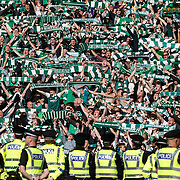 William Hill Scottish Cup Final 2016 Hampden.  Rangers v Hibernian.  Hibs fans celebrate their victory as police keep order. Picture Robert Perry 21st May 2016<br /> <br />  <br /> Must credit photo to Robert Perry<br /> FEE PAYABLE FOR REPRO USE<br /> FEE PAYABLE FOR ALL INTERNET USE<br /> www.robertperry.co.uk<br /> NB -This image is not to be distributed without the prior consent of the copyright holder.<br /> in using this image you agree to abide by terms and conditions as stated in this caption.<br /> All monies payable to Robert Perry<br /> <br /> (PLEASE DO NOT REMOVE THIS CAPTION)<br /> This image is intended for Editorial use (e.g. news). Any commercial or promotional use requires additional clearance. <br /> Copyright 2014 All rights protected.<br /> first use only<br /> contact details<br /> Robert Perry     <br /> 07702 631 477<br /> robertperryphotos@gmail.com<br /> no internet usage without prior consent.         <br /> Robert Perry reserves the right to pursue unauthorised use of this image . If you violate my intellectual property you may be liable for  damages, loss of income, and profits you derive from the use of this image.