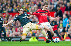 21.03.2010, Old Trafford, Manchester, ENG, PL, Manchester United vs Liverpool FC im Bild Liverpool's Daniel Agger and Manchester United's Michael Carrick, EXPA Pictures © 2010, PhotoCredit: EXPA/ Propaganda/ D. Rawcliffe / SPORTIDA PHOTO AGENCY