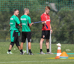 15.07.2013, Walchsee, AUT, FC Augsburg, Trainingslager, im Bild Matthias FETSCH (FC Augsburg #21), √úbungen mit dem Elastikband mit James MORGAN (Physiotherapeut FC Augsburg), Markus ZEYER (Physiotherapeut FC Augsburg, li.) // during a trainings session of German 1st Bundesliga club FC Augsburg at their training camp in Walchsee, Austria on 2013/07/15. EXPA Pictures © 2013, PhotoCredit: EXPA/ Eibner/ Klaus Rainer Krieger<br /> <br /> ***** ATTENTION - OUT OF GER *****