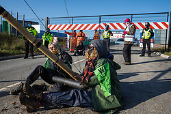 Anti-HS2 activists use an arm tube lock-on and a tripod to block one of several entrances blocked to the Chiltern Tunnel South Portal site for the HS2 high-speed rail link on 9 October 2020 in West Hyde, United Kingdom. The protest action, at the site from which HS2 Ltd intends to drill a 10-mile tunnel through the Chilterns, was intended to remind Prime Minister Boris Johnson that he committed to remove deforestation from supply chains and to provide legal protection for 30% of UK land for biodiversity by 2030 at the first UN Summit on Biodiversity on 30th September.