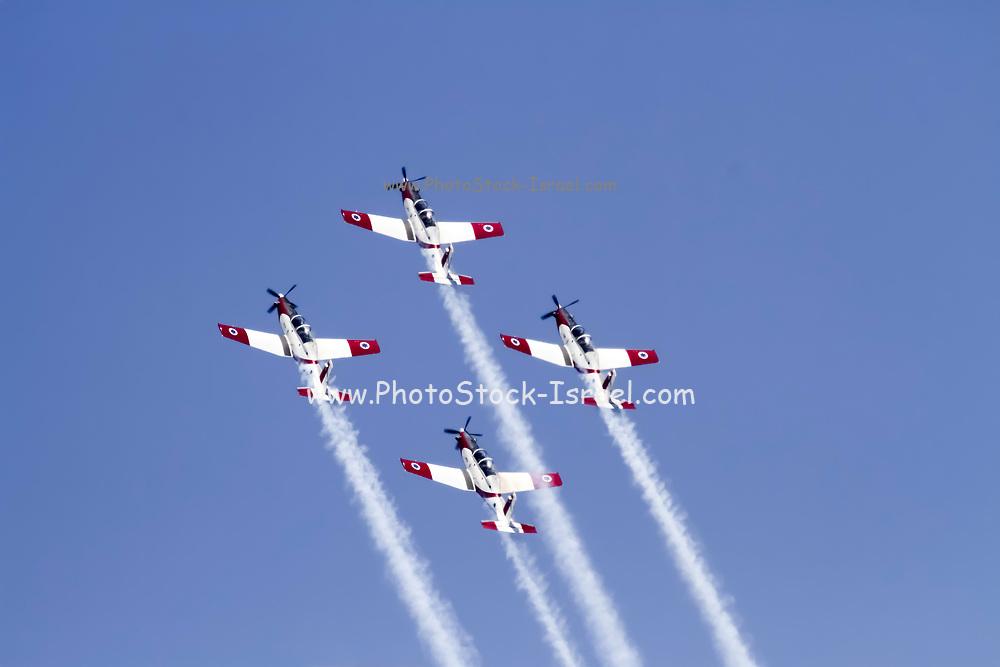 Israeli Air force Flight Academy Beechcraft T-6A Texan II Aerobatics team in flight.
