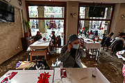 Spain's northeastern Catalonia region is easing restrictions, with bars, cafes, restaurants and gyms reopening in Barcelona on Sunday, Dec 6, 2020. Nightlife is still banned because of a curfew from 10pm, which also applies throughout Spain. Catalonia's eating places can only accept 30% of their normal clientele indoors. Cinemas and concert halls are also reopening, but they can only operate half-full. (VXP Photo/ Vudi Xhymshiti)