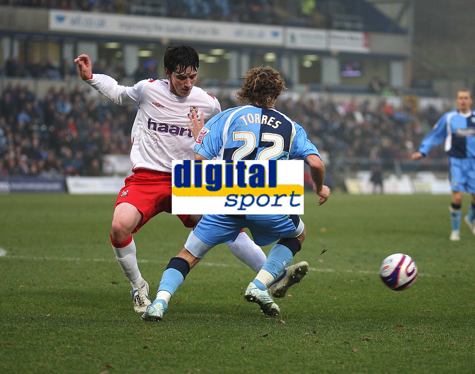 Photo: Karyn Haddon/Sportsbeat Images.<br />Wycombe Wanderers v Lincoln City. Coca Cola League 2. 17/11/2007.<br />Louis Dodds for Lincoln City and Sergio Torres of Wycombe Wanderers battle for the ball.