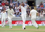 Joe Root (left) and Jonny Bairstow run past frustrated bowler Ishant Sharma during the first Test Match between England and India at Edgbaston, Birmingham. Photo: Graham Morris  / www.photosport.nz