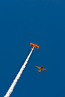 Biplanes do an aerial display above a parade in Littleton, Colorado USA.
