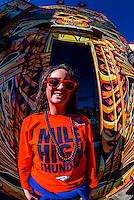 Denver Bronco fan in front of Agave Wheat mural by Nick Hughes, Stoney's Bar and Grill, 1111 Lincoln Street, Denver, Colorado USA.