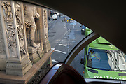 A Waitrose driver waits in traffic beneath the sculptured feet of Prince Albert - one side of the statue to the Royal Consort and Queen Victoria by J. E. Boehm - outside the Royal Courts of Justice at the top of Fleet Street, on 5th October 2020, in London, England.