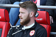 Aron Gunnarsson of Cardiff takes his seat on the bench before k/o . Barclays Premier league match, Cardiff city  v Stoke city at the Cardiff city stadium in Cardiff, South Wales on Saturday 19th April 2014. pic by Mark Hawkins, Andrew Orchard sports photography,