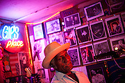 """BESSEMER, AL – OCTOBER 8, 2011: Blues legend Henry """"Gip"""" Gipson, 90, plays on stage during a weekly performances in his backyard juke joint. <br /> <br /> After an altercation with the KKK in the 60's rendered his left hand badly broken, Gipson's method of guitar playing had to change. """"I had to crowd the strings,"""" Gipson said, describing the method that he adopted. Today, Gipson operates Gip's Place, one of few true remaining juke joints in the country. """"Music don't care no color,"""" Gipson said. """"And that's why I love blues, because blues deals with a story to tell you."""""""