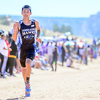 Laguna Acoma Hawk Colton Salvador nears the finish line in third place during the boys varsity race at the Zuni Invitational cross country meet in Zuni Saturday.