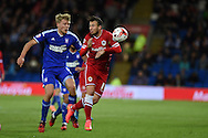 Adam Le Fondre of Cardiff city ® breaks away from Jonathan Parr of Ipswich. Skybet football league championship match, Cardiff city v Ipswich Town at the Cardiff city stadium in Cardiff, South Wales on Tuesday 21st October 2014<br /> pic by Andrew Orchard, Andrew Orchard sports photography.